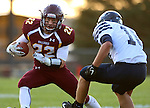 MADISON, SD - SEPTEMBER 11:  Brody Frederiksen #22 from Madison looks to shake past Justin Sebert #18 from West Central in the first half of their game Friday night in Madison. (Photo by Dave Eggen/Inertia)