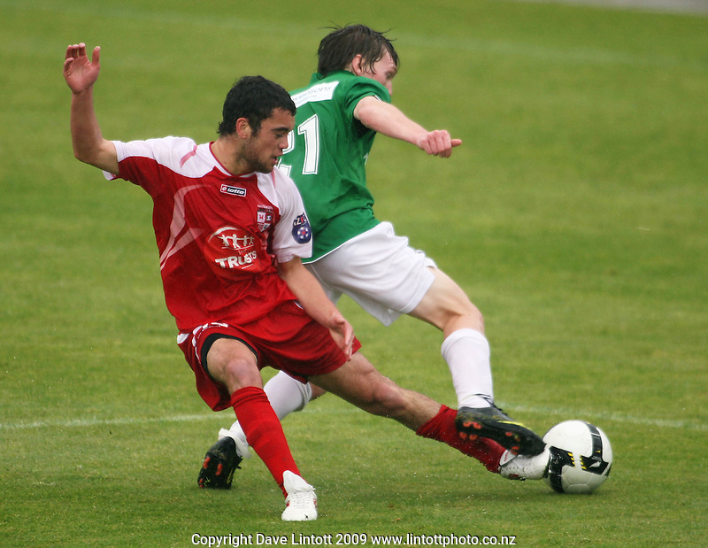 Waitakere's Dakota Lucas tries to tackle the ball off Corey Chettleburgh..NZFC Championship soccer - Youngheart Manawatu v Waitakere United at Memorial Park, Palmerston North. Sunday, 15 November 2009. Photo: Dave Lintott/lintottphoto.co.nz