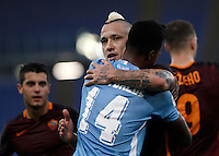Calcio, Serie A: Roma vs Lazio. Roma, stadio Olimpico, 8 novembre 2015.<br /> Lazio's Keita Diao, back to camera, greets Roma's Radja Nainggolan at the end of the Italian Serie A football match between Roma and Lazio at Rome's Olympic stadium, 8 November 2015. Roma won 2-0.<br /> UPDATE IMAGES PRESS/Isabella Bonotto
