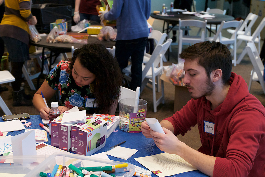 Kayla Smith '18 and James Cannellos '17 make cards for the elderly. Emerson's Martin Luther King Day of Service organized by City Mission Society of Boston. Volunteers can make trail mix and scarves to be shared by Operation Boston Warm to people displaced by the closing of the Long Island Shelter. They can write messages of hope for Ribbons of Hope to be given throughout Ferguson, Missouri. People can also craft cards to be given by Ethos to the elderly.