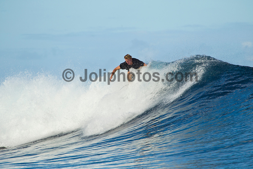 Teahupoo, Tahiti Iti, French Polynesia. Thursday August 17 2011.Dusty Payne (HAW).  A south  west swell was hitting the main reef today with clean open barrels in the six foot range. Photo: joliphotos.com