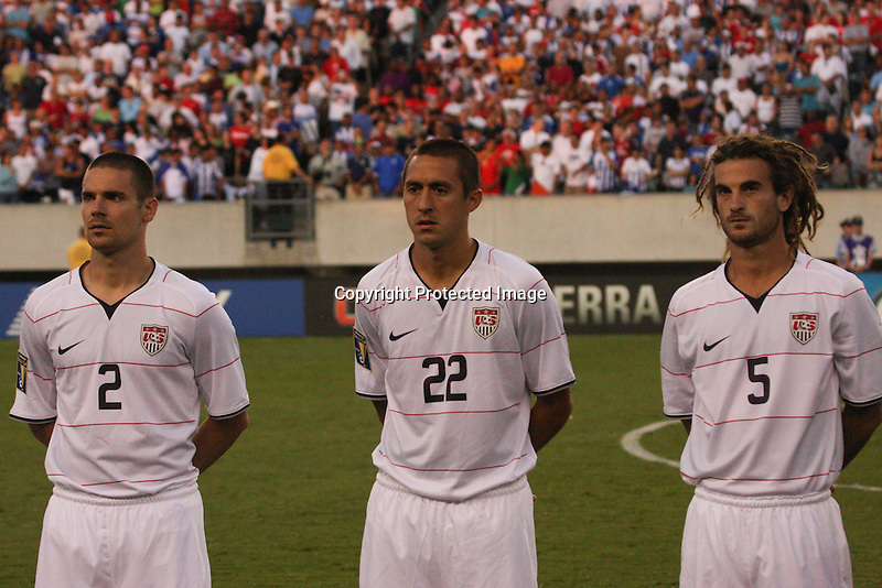 #2 Heath Pearce, #22 Davy Arnaud, and # 5 Kyle Beckerman while playing the national anthem.  CONCACAF Gold Cup quarterfinal against Panama at Lincoln Financial Phila PA 07.18.09