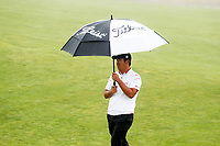 Beyond Hun An (Korea) walks the 13th hole in the rain during the Wednesday practice round of the 118th U.S. Open Championship at Shinnecock Hills Golf Club in Southampton, NY, USA. 13th June 2018.<br /> Picture: Golffile | Brian Spurlock<br /> <br /> <br /> All photo usage must carry mandatory copyright credit (&copy; Golffile | Brian Spurlock)