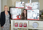 Competition Winner Angela Evans with her prizes with Redrow Sales Director Debby Pavitt<br /> <br /> Kitchen appliance competition -  Redrow Show Homes - Cwm Calon - Ystrad Mynach<br /> <br /> &copy; www.fotowales.com- PLEASE CREDIT IAN COOK
