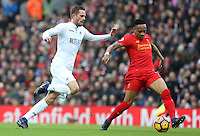 Gylfi Sigurdsson of Swansea City  challenges Nathaniel Clyne of Liverpool during the Premier League match between Liverpool and Swansea City at Anfield, Liverpool, Merseyside, England, UK. Saturday 21 January 2017