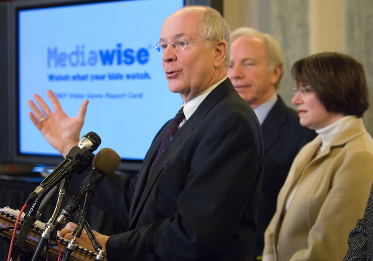 From left, Dr. David Walsh, president and founder of the National Institute on Media and the Family, Sen. Joe Lieberman, I-Conn., and Sen. Amy Klobuchar, D-Minn., participate in the news conference to release the 12th annual video game report card on Tuesday, Dec. 4, 2007.