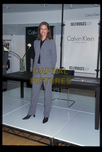 CHRISTIE TURLINGTON.At Selfridges promoting Calvin Klein underwear.Ref:7026.grey, gray suit, full length, full-length.*RAW SCAN- photo will be adjusted for publication*.www.capitalpictures.com.sales@capitalpictures.com.©Capital Pictures
