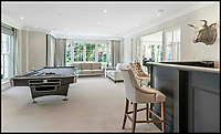 BNPS.co.uk (01202 558833)<br /> Pic: Savills/BNPS<br /> <br /> Three-mendous!<br /> <br /> Pool table and bar.<br /> <br /> Stunning seaside estate overlooking Sandbanks that wouldn't look out of place in the Hollywood Hills - and you get three properties for your &pound;9 million price tag.<br /> <br /> You get three luxury homes for the price of one with this spectacular private coastal estate - but they will still need deep pockets as the trio of properties are on the market for &pound;8.995m.<br /> <br /> The Mulberry House Estate is in the leafy Canford Cliffs area of Poole, Dorset, and has a grand five-bedroom mansion, a second detached five-bedroom house and a two-bedroom gate house.<br /> <br /> Locals describe the Canford Cliffs area as the 'Hollywood Hills' of the coastal property hotspot, more refined and less showy than the more 'Malibu style' Sandbanks peninsula that it overlooks.<br /> <br /> Offering beautiful views but with privacy and seclusion, and without the tourist crowds that the Sandbanks millionaire's enclave attracts.<br /> <br /> Estate agent Savills say the sale is a &quot;unique opportunity&quot; as the 2.2 acre Mulberry property is the only private estate in the area.