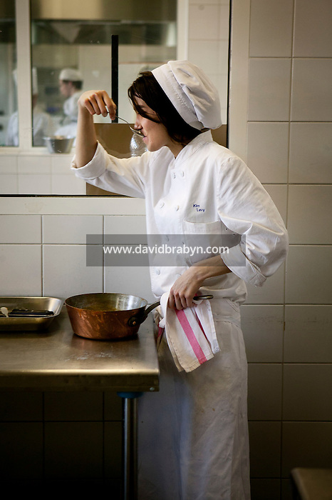A student tastes a dish during a class at the Ecole Superieure de Cuisine Francaise Gregoire Ferrandi cooking school in Paris, France, 18 December 2007.