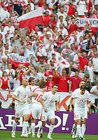 Players celebrate after Bartosz Bosacki's (19)second goal. Poland defeated Costa Rica 2-1 in their FIFA World Cup Group A match at FIFA World Cup Stadium, Hanover, Germany, June 20, 2006.