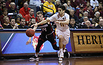 SIOUX FALLS, SD: MARCH 20:  DJ Pollard #11 of Northern State and Ryan Krawczeniuk #14 of East Stroudsburg chase a loose ball during their game at the 2018 Division II Men's Elite 8 Basketball Championship at the Sanford Pentagon in Sioux Falls, S.D. (Photo by Dick Carlson/Inertia)