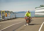 Puget Sound. Seattle- Bremerton Ferry. Coleman Dock Pier 52. Cyclist commuter.