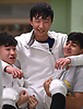Sean Pak of Commack, center, gets a congratulatory hoist from teammates Joon Lee, left, and Arham Sheikh after winning the boys epee portion of the Brentwood Holiday Tournament at Brentwood High School on Saturday, Dec. 15, 2018.