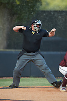 The home plate umpire calls a batter out on strikes during an American Legion baseball game between Mooresville Post 66 and Kannapolis Post 115 at Northwest Cabarrus High School on May 30, 2019 in Concord, North Carolina. Mooresville Post 66 defeated Kannapolis Post 115 4-3. (Brian Westerholt/Four Seam Images)