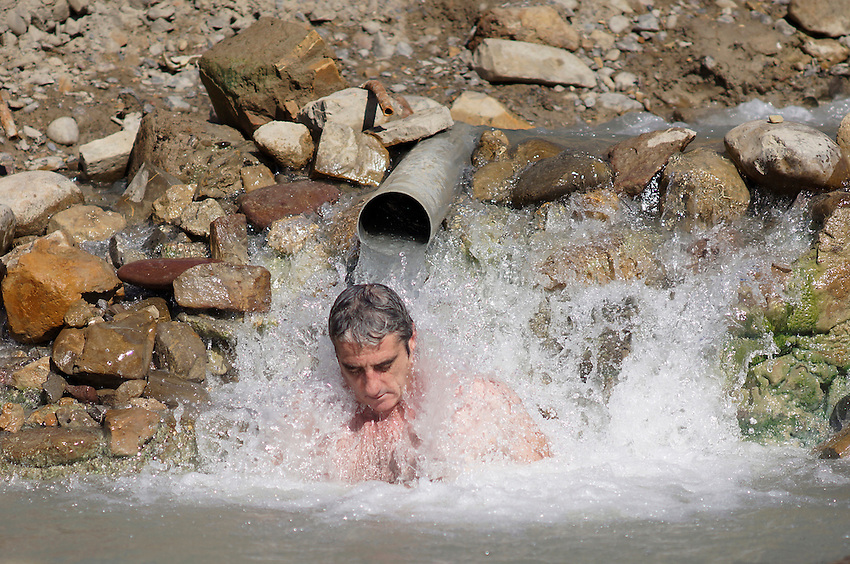 A man repose in the ancient Baths of sulphurous waters of Tiermas on October 13, 2012, in the Spanish reservoir of Yesa. The ancient baths of sulphurous waters of Tiermas are under Yesa reservoir waters and return to the surface when the reservoir is running low on water.  Photo: Ander Gillenea