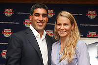 New York Red Bulls captain Claudio Reyna poses for photographers with his wife Danielle during a press conference announcing his retirement from professional soccer at St. Benedict's Prep in Newark, New Jersey, on July 16, 2008. Claudio Reyna played two years for the New York Red Bulls after playing 12 years in Europe and earning 112 caps for the US national team. Reyna started his career at St. Benedict's being named Parade Magazine national high school player of the year twice.