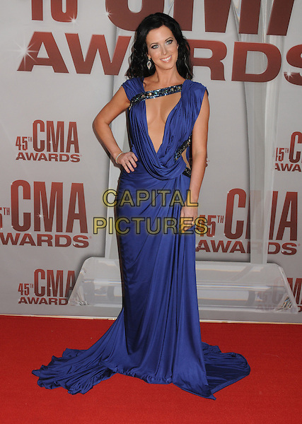 Shawna Thompson of Thompson Square.The 45th Annual CMA Awards, Country Music's Biggest Night, held at Bridgestone Arena, Nashville, Tennessee, USA..November 9th, 2011.full length blue dress cleavage  plunging neckline cleavage hand on hip.CAP/ADM/BP.©Byron Purvis/AdMedia/Capital Pictures.