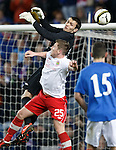 Goalkeeper Alan Smith makes his debut for Rangers as he clears from Mark McAllister