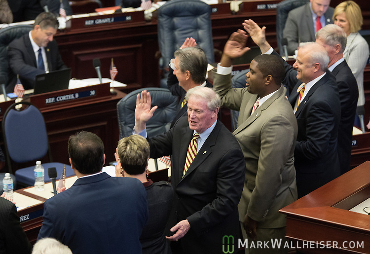 Former Speaker of the House and current president of Florida State University, John Thrasher, along with other House members, do the Seminole Chop as the Florida House of Representatives convenes at the Florida Capitol.