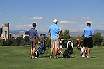 Men ready to tee off at City Park Golf Course, with the downtown skyline and the Rocky Mountains, Colorado.
