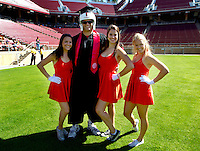 Members of Stanford University football team and Field Hockey team participate in the traditional Wacky Walk at Stanford Stadium during 122nd Commencement program on Sunday, June 16, 2013.