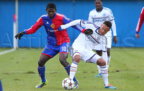 26.11.2013. FCB Campus, Basel, Switzerland.  UEFA Youth League FC Basel versus Chelsea FC. Breel Donald Embolo (li,FC Basel) challenges Lewis Baker (Chelsea)