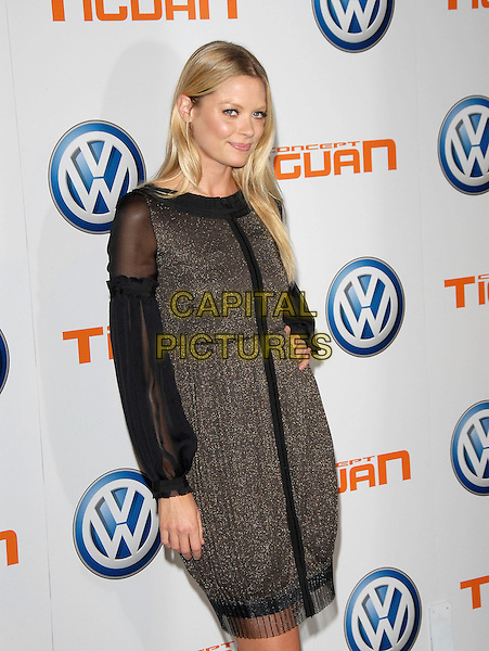 JAIME KING.attends Volkswagen US Premiere of Concept Tiguan held at Raleigh Studios in Los Angeles, California, USA,.November 28, 2006..half length black sparkly glittery dress hand on hip  jamie .CAP/DVS.©Debbie VanStory/Capital Pictures