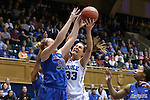 24 March 2014: Duke's Haley Peters (33) and DePaul's Megan Podkowa (30) challenge for a rebound. The Duke University Blue Devils played the DePaul University Blue Demons in an NCAA Division I Women's Basketball Tournament Second Round game at Cameron Indoor Stadium in Durham, North Carolina. DePaul won the game 74-65.