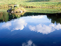 SKY REFLECTED IN WATER<br /> Clouds reflected in pond<br /> The water's reflective surface creates a virtual image of the sky