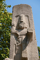 Close up of the Hittite Fasillar Monument, finished replica of 13th century BC original. Anatolian Civilisations Museum, Ankara, Turkey<br /> <br /> The original is an unfinished monumental stele that is situated fiat on the back on a slope at the immediate vicinity of the village Fasillar within the Konya province, Beysehir. This is an exact replica of the original that was made of trachyte igneous rock. This represents the origin&amp; that was cast into the mould of the same dimensions and colour. <br /> <br /> The height from the toes to the top of the lions is 7,40 meters. There is also a socket that is 80 cm. Long inserted into the basement. The Hittite monument dates from the end of 13th century BC There appears the great God higher than 4 meters stepping on the smaller mountain God that is accompanied by the lions on.