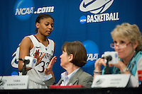 NORFOLK, VA--Amber Orrange receives a high five from Head coach Tara VanDerveer after completing her first post-season press confrerence after defeating West Virginia University at the Ted Constant Convocation Center at Old Dominion University for the second round of the 2012 NCAA Championships. The Cardinal advanced to the West Regionals in Fresno with a score of 72-55.