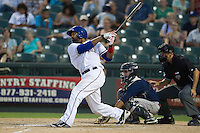 Round Rock Express outfielder Joey Butler (16) follows through on his swing against the Oklahoma City RedHawks during the Pacific Coast League baseball game on August 25, 2013 at the Dell Diamond in Round Rock, Texas. Round Rock defeated Oklahoma City 9-2. (Andrew Woolley/Four Seam Images)