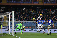 Cristiano Ronaldo of Juventus climbs above Nicola Murru of Sampdoria to head the ball past Emil Audero in the Sampdoria to give the side a 2-1 lead during the Serie A match at Luigi Ferraris, Genoa. Picture date: 18th December 2019. Picture credit should read: Jonathan Moscrop/Sportimage PUBLICATIONxNOTxINxUK SPI-0378-0020<br /> Sampdoria - Juventus  <br /> Photo Jonathan Moscrop / Sportimage / Imago / Insidefoto