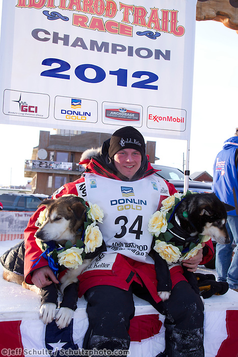 Tuesday March 13, 2012   Dallas Seavey poses with his lead dogs Guiness (R) and  Diesel (L) at the finish in Nome shorlty after Dallas won the 2012 Iditarod