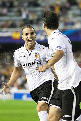 02.10.2012 Valencia, Spain. Jonas Gonçalves (R) of Valencia CF celebrates with Forward Roberto Soldado after scoring the first goal for his team, Jonas first Goal during the Champions League Group G game between Valencia   and Lille from Mestalla, Valencia, Spain.