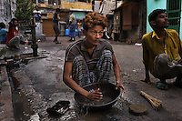 Artisanal gold smiths in Kolkata (Calcutta)....These guys make about 3-400 USD a month at the top end.  They live in the workplace....Jewelry worker area early in the morning.  They sweep the streets at 1am thru the night when they are clear of people. They then pan for gold in the early hours.