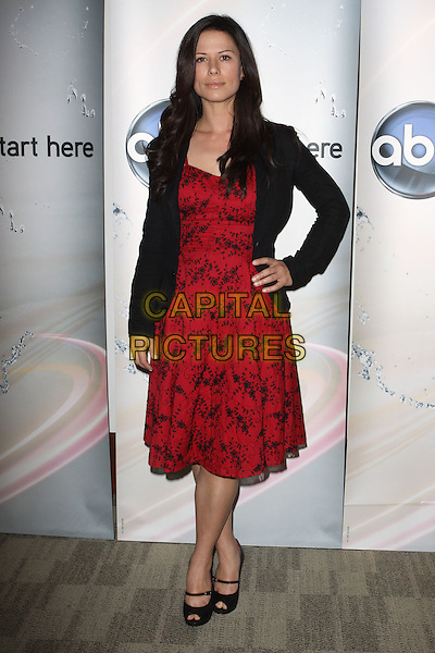 RHONA MITRA.Disney/ABC Television Group Press Junket held At The ABC Television Network Building, Burbank, California, USA..May 15th, 2010.full length leather jacket black red pattern print dress hand on hip peep toe mary janes shoes .CAP/ADM/KB.©Kevan Brooks/AdMedia/Capital Pictures.