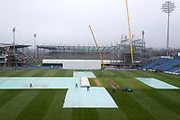 Ground staff start to remove the covers during Yorkshire CCC vs Essex CCC, Specsavers County Championship Division 1 Cricket at Emerald Headingley Cricket Ground on 13th April 2018