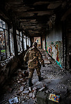 Pisky, Nr Avdiivka, eastern Ukraine, Nov. 2017.<br /> <br /> A serviceman in the Ukrainian army, walks through the remains of the school in the devastated village of Pisky, on the outskirts of Avdiivka in eastern Ukraine.<br /> <br /> The village is on the front-line and under frequent attack by sniper, rocket and artillery fire from pro-Russian separatists.