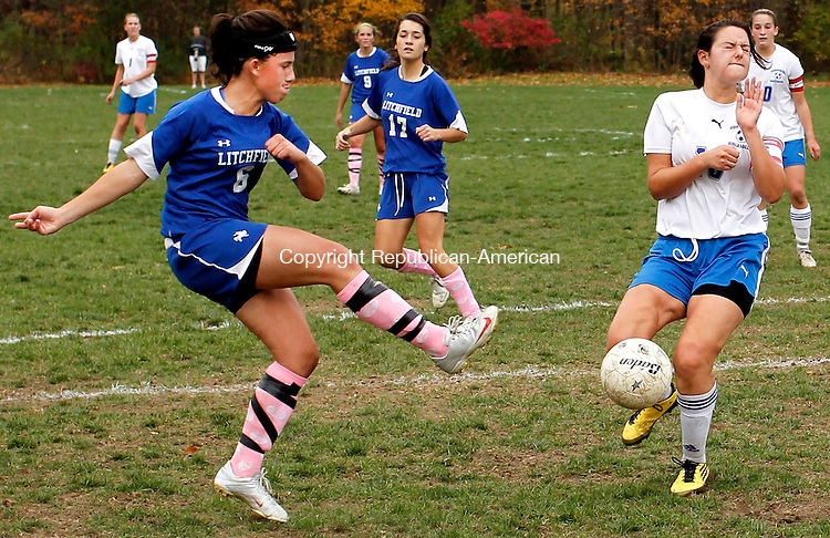 Woodbury, CT- 26, October 2010-102610CM04  Litchfield's Ellie Motta clears the ball which deflects off Nonnewaug's Ashley Mancini Tuesday afternoon in Woodbury. Nonnewaug blanked the Cowboys 5-0.  Christopher Massa Republican-American