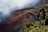 Not unusual for clouds to obscure the cinder cones in the crater of HALEAKALA NATIONAL PARK on Maui in Hawaii