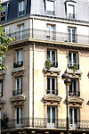 Apartment block in Paris with high windows. Paris, France.