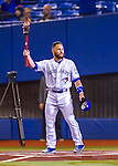2 April 2016: Toronto Blue Jays catcher Russell Martin carries an Olympic Flame Torch to commemorate the 40th anniversary of the Montreal Olympic Games, held in 1976, prior to a pre-season exhibition game against the Boston Red Sox at Olympic Stadium in Montreal, Quebec, Canada. The Red Sox defeated the Blue Jays 7-4 in the second of two MLB weekend games, which saw a two-game series attendance of 106,102 at the former home on the Montreal Expos. Mandatory Credit: Ed Wolfstein Photo *** RAW (NEF) Image File Available ***