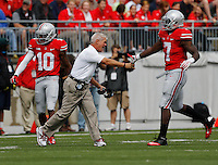 Ohio State special teams coordinator Kerry Coombs high fives Ohio State Buckeyes running back Rod Smith (7) after the Buckeyes blocked a punt during the first quarter of the NCAA football game at Ohio Stadium in Columbus on Sept. 21, 2013. (Adam Cairns / The Columbus Dispatch)