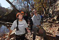 NWA Democrat-Gazette/FLIP PUTTHOFF <br /> Katherine Magana (left) and teacher Jeff Belk encourage student climbers scaling a bluff on Nov. 16 2018 at Lincoln Lake. Rogers High School outdoor education students were up to the challenge of climbing the 45-foot cliff and rapeling down.