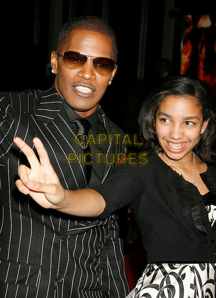 "JAMIE FOXX & CORRINE FOXX.""Dreamgirls"" Los Angeles Premiere held at the Wilshire Theatre, Beverly Hills, California, USA..December 11th, 2006.headshot portrait sunglasses shades father daughter family black pinstripe peace v sign hand.CAP/ADM/RE.©Russ Elliot/AdMedia/Capital Pictures"