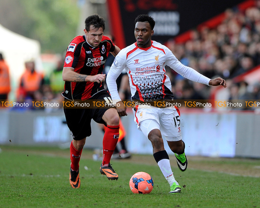 Daniel Sturridge of Liverpool gets away from Charlie Daniels of AFC Bournemouth - AFC Bournemouth vs Liverpool - FA Cup 4th Round Football at the Goldsands Stadium, Bournemouth, Dorset - 25/01/14 - MANDATORY CREDIT: Denis Murphy/TGSPHOTO - Self billing applies where appropriate - 0845 094 6026 - contact@tgsphoto.co.uk - NO UNPAID USE