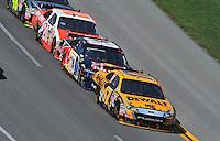 Apr 26, 2009; Talladega, AL, USA; NASCAR Sprint Cup Series driver Matt Kenseth (17) leads Brian Vickers (83) and Joey Logano (20) during the Aarons 499 at Talladega Superspeedway. Mandatory Credit: Mark J. Rebilas-