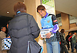 March 22, 2011, Kawasaki City, Kanagawa Prefecture, Japan - Professional soccer players from Kawasaki Frontale, a J-League soccer team from Kawasaki, Kanagawa Prefecture, Japan, pitch in at Kawasaki Station to gather donations for survivors of the 2011 Tohoku-Kanto Natural Disaster. The J-League season will be paused for a month and a half due to damage sustained in the earthquakes and tsunami. (Photo by Atsushi Tomura/AFLO)