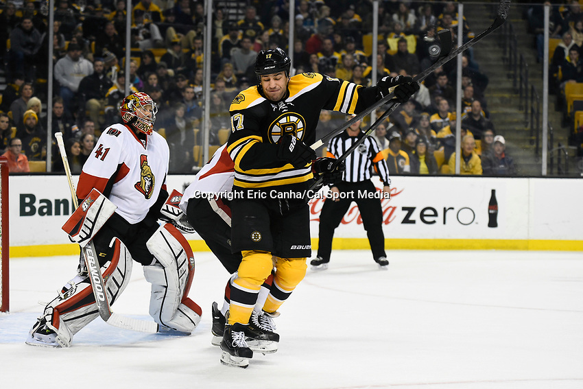 January 3, 2015 - Boston, Massachusetts, U.S. - Boston Bruins left wing Milan Lucic (17) redirects the puck during the NHL game between the Ottawa Senators and the Boston Bruins held at TD Garden in Boston Massachusetts. Eric Canha/CSM